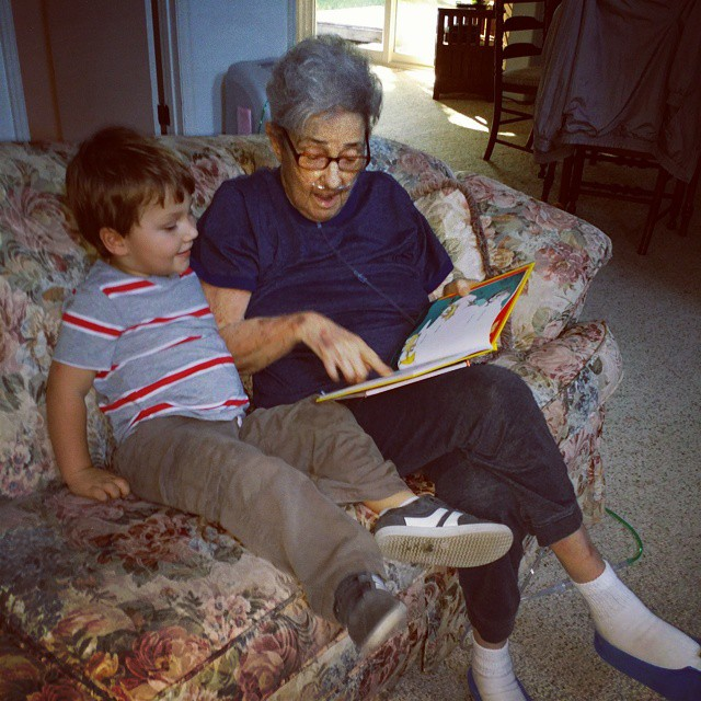 Woman reads Dr. Suess to a small child